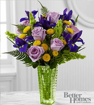 Say thank you with a flower arrangement or garden plant veldkamps this garden style flower arrangement has lavender roses purple iris yellow button poms bells of ireland and sword fern creating an eye catching mightylinksfo